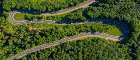 Winding road in the forest. Eifel, germany, Europe. Car passing on road. Drone Shot- Stock Photo or Stock Video of rcfotostock | RC-Photo-Stock