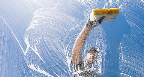 window cleaner cleaning window with sponge on a sunny day - Stock Photo or Stock Video of rcfotostock | RC-Photo-Stock