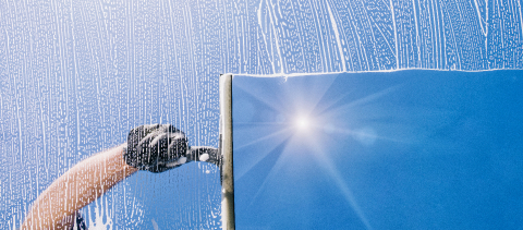 Window cleaner cleans window with foam and puller, banner size- Stock Photo or Stock Video of rcfotostock | RC-Photo-Stock