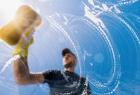 window cleaner with sponge cleaning glass window, Cleaning conept image- Stock Photo or Stock Video of rcfotostock | RC-Photo-Stock