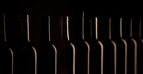 Wine bottles in a row on black  background, close up : Stock Photo or Stock Video Download rcfotostock photos, images and assets rcfotostock | RC-Photo-Stock.: