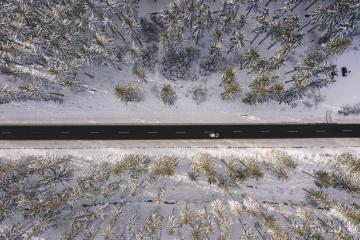 Winter snow covered pine forests and road with car bird's eye view- Stock Photo or Stock Video of rcfotostock | RC-Photo-Stock