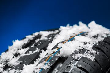 winter tires with snow and ice on blue background : Stock Photo or Stock Video Download rcfotostock photos, images and assets rcfotostock | RC-Photo-Stock.: