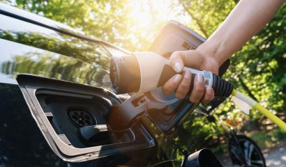 woman Charging battery of an electric car : Stock Photo or Stock Video Download rcfotostock photos, images and assets rcfotostock | RC-Photo-Stock.: