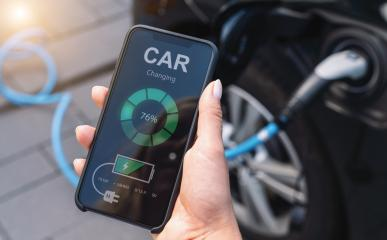 Woman Charging Electric car with Cable Looking at App On Mobile Phone. Close up of smartphone screen. Hand holding smart device. Mobile application for eco transportation.  : Stock Photo or Stock Video Download rcfotostock photos, images and assets rcfotostock | RC-Photo-Stock.: