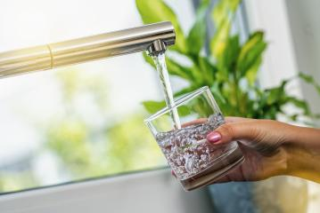 woman hand holds a glass to Filing it with water from tap- Stock Photo or Stock Video of rcfotostock | RC-Photo-Stock
