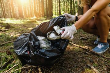 woman hand picking up a canned tin to clean up the forest from garbage. nature and environment cleaning concept image. : Stock Photo or Stock Video Download rcfotostock photos, images and assets rcfotostock | RC-Photo-Stock.: