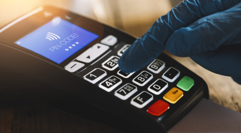 Woman hand with medical latex protective gloves enters PIN code on payment terminal in a cafe. Protection for Coronavirus or COVID-19. - Stock Photo or Stock Video of rcfotostock | RC-Photo-Stock
