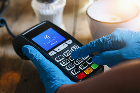 Woman hand with medical latex protective gloves holds payment terminal and enters PIN code at a cafe. Protection for Coronavirus or COVID-19. - Stock Photo or Stock Video of rcfotostock | RC-Photo-Stock