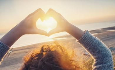 Woman hands in Heart symbol shaped with sunset light on the beac- Stock Photo or Stock Video of rcfotostock | RC-Photo-Stock