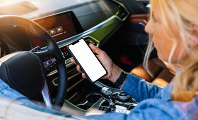 Woman holding black mobile phone in hands with blank desktop screen while car driving at summer in the city, Mockup image- Stock Photo or Stock Video of rcfotostock | RC-Photo-Stock