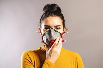Woman holding ffp3 or ffp2 protection face mask against coronavirus outbreak COVID-19. : Stock Photo or Stock Video Download rcfotostock photos, images and assets rcfotostock | RC-Photo-Stock.: