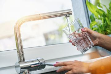 woman holding glass at water tap and filling water- Stock Photo or Stock Video of rcfotostock | RC-Photo-Stock