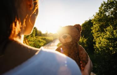 Woman holding teddy bear toy at sunset, copyspace for your individual text.- Stock Photo or Stock Video of rcfotostock | RC-Photo-Stock