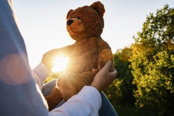 Woman holding teddy bear toy with sunlight at sunset : Stock Photo or Stock Video Download rcfotostock photos, images and assets rcfotostock | RC-Photo-Stock.: