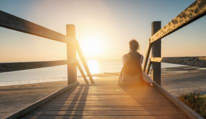 woman is sitting on a wooden path to the Baltic sea at sunset an : Stock Photo or Stock Video Download rcfotostock photos, images and assets rcfotostock | RC-Photo-Stock.:
