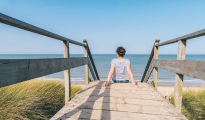 woman ís sitting on a wooden path to the Baltic sea over sand dunes with ocean view- Stock Photo or Stock Video of rcfotostock | RC-Photo-Stock