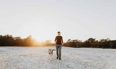 Woman is walking on the sand with his dog on the beach and having fun. Friendship between woman and husky. They are cheerful, happy and enjoy life. : Stock Photo or Stock Video Download rcfotostock photos, images and assets rcfotostock | RC-Photo-Stock.: