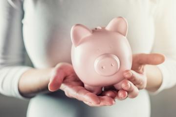 woman keep a piggy bank carefully- Stock Photo or Stock Video of rcfotostock | RC-Photo-Stock