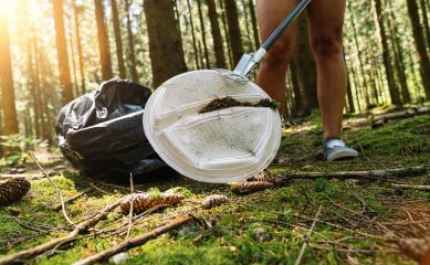 woman picking up garbage plastic with a picker for cleaning the forest, nature and environment cleaning concept image. : Stock Photo or Stock Video Download rcfotostock photos, images and assets rcfotostock | RC-Photo-Stock.: