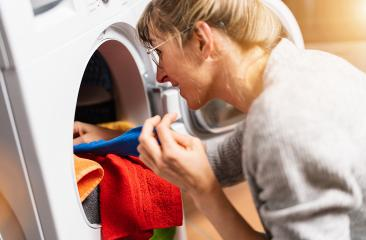 Woman putting clothes out washing machine or dryer, home laundry service, daily routine : Stock Photo or Stock Video Download rcfotostock photos, images and assets rcfotostock | RC-Photo-Stock.: