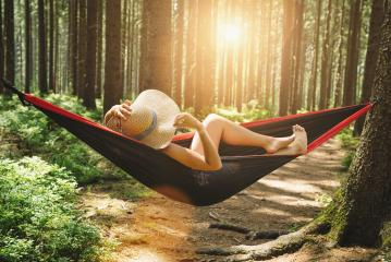 Woman relaxing at the forest on a hammock- Stock Photo or Stock Video of rcfotostock | RC-Photo-Stock