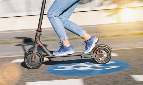 woman riding electric kick scooter or e-scooter over a Bicycle road sign at cityscape, motion blur- Stock Photo or Stock Video of rcfotostock | RC-Photo-Stock