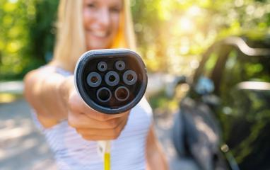 Woman shows Type 2 plug charging cable for Electric car or EV Car to charging. Eco-friendly alternative energy concept  : Stock Photo or Stock Video Download rcfotostock photos, images and assets rcfotostock | RC-Photo-Stock.: