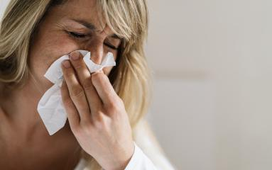 Woman sits in bed after corona infection, blowing her nose using paper napkin tissue. Sick woman suffering from running stuffy nose and sore throat. Cold and Flu Concept image : Stock Photo or Stock Video Download rcfotostock photos, images and assets rcfotostock | RC-Photo-Stock.: