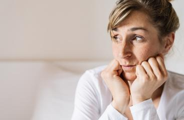 woman Sitting On Bed woke up in early morning leans head on palms, feels tired not enough of rest, insomnia sleep disorder anxious by personal problems, unhealthy migraine and headache concept : Stock Photo or Stock Video Download rcfotostock photos, images and assets rcfotostock | RC-Photo-Stock.: