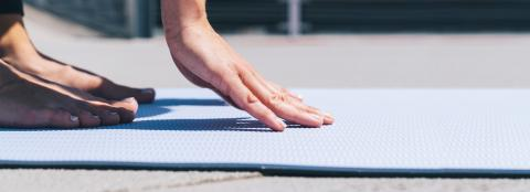 Woman starts stretching workout on a yoga mat outside, with focus on hands. copyspace for your individual text.- Stock Photo or Stock Video of rcfotostock | RC-Photo-Stock