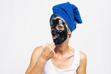 Woman using Face Mask. Portrait Of Beautiful woman that uses a Cosmetic Black Peeling Mask From Facial Skin. Closeup Of Attractive Woman With Natural Makeup And Cosmetic Peel Mask On Face and wrapped : Stock Photo or Stock Video Download rcfotostock photos, images and assets rcfotostock | RC-Photo-Stock.: