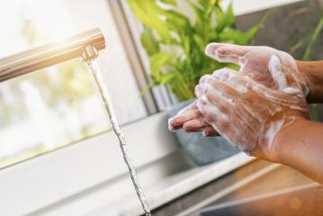 Woman washing of hands with soap under running water in the kitchen- Stock Photo or Stock Video of rcfotostock | RC-Photo-Stock
