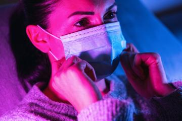 Woman wearing an anti virus protection mask to prevent others from corona COVID-19 and SARS cov 2 infection at a gaming event : Stock Photo or Stock Video Download rcfotostock photos, images and assets rcfotostock | RC-Photo-Stock.: