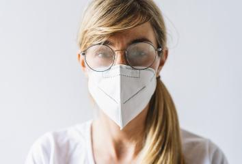 Woman wearing N95 FFP2 an anti virus protection mask and glasses are fogged up to prevent others from corona COVID-19 and SARS cov 2 infection : Stock Photo or Stock Video Download rcfotostock photos, images and assets rcfotostock | RC-Photo-Stock.: