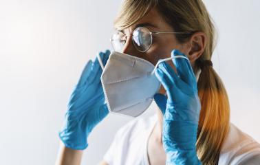 Woman wearing N95 FFP2 an anti virus protection mask to prevent others from corona COVID-19 and SARS cov 2 infection- Stock Photo or Stock Video of rcfotostock | RC-Photo-Stock