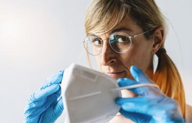 Woman wearing N95 FFP2 an anti virus protection mask to prevent others from corona COVID-19 and SARS cov 2 infection- Stock Photo or Stock Video of rcfotostock   RC-Photo-Stock