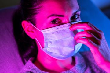 woman wearing virus face mask protection in colourful bright neon uv lights posing at a club or disco : Stock Photo or Stock Video Download rcfotostock photos, images and assets rcfotostock | RC-Photo-Stock.: