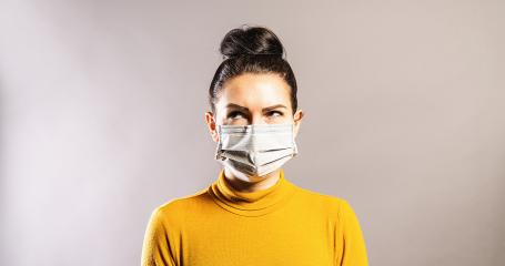 Woman with anti virus protection mask to prevent others from corona COVID-19 and SARS cov 2 infection  looking up over - Stock Photo or Stock Video of rcfotostock | RC-Photo-Stock