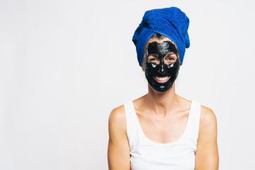 Woman with purifying black mask on her face and wrapped bath towel on the head  : Stock Photo or Stock Video Download rcfotostock photos, images and assets rcfotostock | RC-Photo-Stock.: