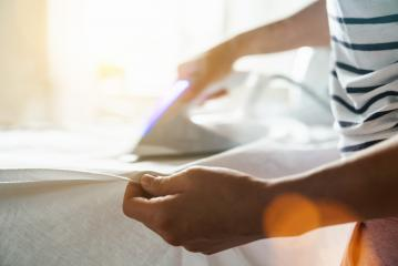 Women ironing clothes on ironing board in laundry room at home, copyspace for your individual text. : Stock Photo or Stock Video Download rcfotostock photos, images and assets rcfotostock | RC-Photo-Stock.:
