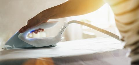Women ironing clothes on ironing board in laundry room at home : Stock Photo or Stock Video Download rcfotostock photos, images and assets rcfotostock | RC-Photo-Stock.: