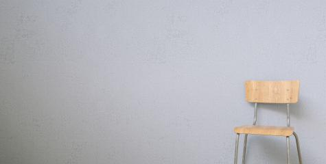 wooden chair in front of a grey wall, with copy space for individual text - Stock Photo or Stock Video of rcfotostock | RC-Photo-Stock