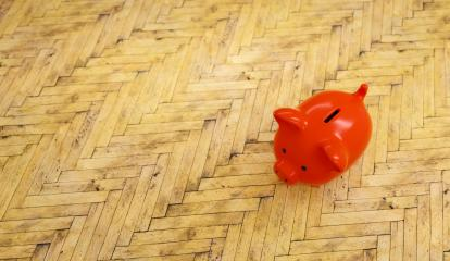 wooden floor with a red piggy bank  - copyspace for your individual text.- Stock Photo or Stock Video of rcfotostock | RC-Photo-Stock