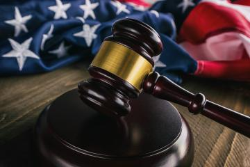 Wooden Gavel with American Flag on a wooden table- Stock Photo or Stock Video of rcfotostock | RC-Photo-Stock
