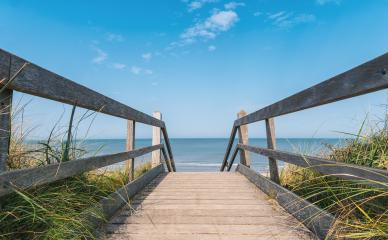 Wooden path at Baltic sea over sand dunes with ocean view- Stock Photo or Stock Video of rcfotostock | RC-Photo-Stock