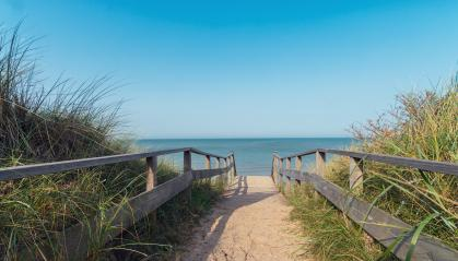 Wooden path at north sea over sand dunes with ocean view- Stock Photo or Stock Video of rcfotostock | RC-Photo-Stock