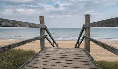 Wooden path at north sea over sand dunes with ocean view on a cl- Stock Photo or Stock Video of rcfotostock | RC-Photo-Stock