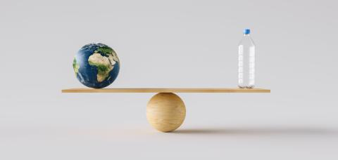 wooden scale balancing big Earth ball and plastic bottle. Concept of environmental Protection and balance- Stock Photo or Stock Video of rcfotostock | RC-Photo-Stock