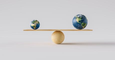 wooden scale balancing big Earth ball and small Earth ball. Concept of harmony and balance- Stock Photo or Stock Video of rcfotostock | RC-Photo-Stock